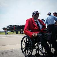 Former Air Force ground mechanic Homer Hogues, among the few surviving Tuskegee Airmen, was on hand to kick off this week's Wings of Freedom tour featuring vintage World War II aircraft.  (Marc Ramirez/Staff)