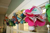 Colorful bunting made from fabric scraps adorn windows in Urban Spools. When Kitto opened at the Casa Linda location in May, her friends helped her make the decorations.