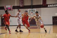 Rowlett senior Tristan Munoz drives into the lane against Garland Naaman Forest. Rowlett is now under the direction of head coach Jason Busch, who left Garland Lakeview Centennial to replace now-retired coach Stan Blackmon at Rowlett.( Staff photo by CHRIS DERRETT )