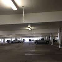 NorthPark Center is installing this type of parking system in the Macy's garage. Those red or green lights above a space and a digital sign at the garage entrance let you know where the empty spots are and on what level. This photo was taken at the Nebraska Furniture Mart garage in The Colony. (Staff Photo)