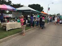 Guests shop for goods such as homemade pickles and wooden yard art at the nearly 40 vendors that lined Main Street on June 21 at the duncanSWITCH Street Market.Photo submitted by DANIEL FLORES