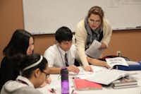 Ninth-grade AP Human Geography teacher Karen Alexander instructs students at Garland's International Leadership of Texas charter school.(Staff photo by CHRIS DERRETT)
