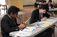 Students at Garland's International Leadership of Texas charter school create collages. Basic math, science and social studies courses taught at the school are Advanced Placement and pre-Advanced Placement courses.(Staff photo by CHRIS DERRETT)