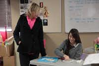 Art and journalism teacher Claire Sneau instructs a student at Garland's International Leadership of Texas charter school. The school aims to have one Chinese student for every three American students.(Staff photos by CHRIS DERRETT)