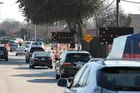 Traffic is forced to avoid the left lane on Alma Drive between Parker Road and Spring Creek Parkway. Construction at several Plano intersections has created slower traffic for commuters, but officials say it will solve long-term problems upon completion.(Staff photo by CHRIS DERRETT)