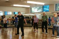 Marilyn Kramer (center left) leads the Young at Heart Line Dancers during a class at Harry Stone Recreation Center. Line dancing is one of several classes offered at the center.