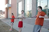 Rockwall swimmers (from left) Raena Eldridge and William Rapp and Rockwall-Heath swimmer Jared Butler complete a circuit of dry land exercises as they prepare for the state championships. Rockwall ISD sends four swimmers to the 2014 state championships, which begin Friday in Austin.( Staff photo by CHRIS DERRETT )