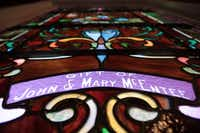 The stained glass windows of Sacred Heart Catholic Church's chapel list names of families who helped build the chapel in 1899.Staff photo by CHRIS DERRETT  -  neighborsgo