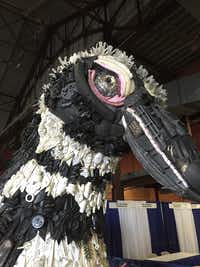 This 9-foot penguin is made from plastic trash found on Oregon beaches. The art was created by the Washed Ashore Project and is on display at Earth Day Texas. (Jeff Mosier/Dallas Morning News)