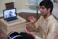 Plano High School junior Jay Appaji reviews a mridangum lesson with his instructor, percussionist Rohan Krishnamurthy, via Skype. With the $2,500 earned through the 2014 Young Masters grant program, Appaji will attend the Rhythmic Souls Music summer program in Dallas to work on a mridangam and tap dance project. It will be the first collaboration of its type.Staff photo by CHRIS DERRETT  -  neighborsgo