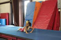 Mikiyah Tanner smiles after practicing tumbling at Twister Spirit Athletics in Cedar Hill.Staff photo by CHRIS DERRETT - neighborsgo