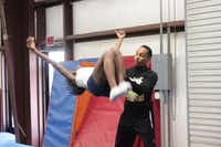 Tumbling coach Josh Benjamin assists a team member during practice at Twister Spirit Athletics' gym in Cedar Hill.Staff photos by CHRIS DERRETT - neighborsgo