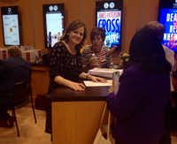 "Maria Semple signs a promotional handout for ""Today Will Be Different"" at BookExpo America."