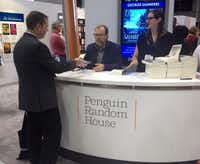"George Saunders signs advance copies of ""Lincoln in the Bardo"" at BookExpo America."