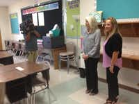 Principal Lisa Millsaps (right) and former MISD Superintendent Linda Henrie led a walking tour of Henrie Elementary School before it opened in fall 2015. Mesquite ISD's largest elementary, the school was built for 1,000 students in a growing area of Dallas on the southern outskirts of the district. High school students in the same area, however, travel nearly six miles each way, past other high schools, under the district's current feeder system.(Ray Leszcynski/Staff)