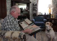 Harold Green looks at the original deed of the Munger Place home he and his wife, Gale, have owned since the 1970s. Because the home is located in a historic district, the Greens faced strict requirements when repairing damage following last year's hailstorm.