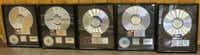 A Hip-Hop Hall of Fame's worth of platinum belonging to Tracy Curry