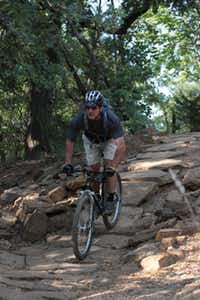 Fran Desautels navigates a rock hill on Murrell Park's Northshore Trail.