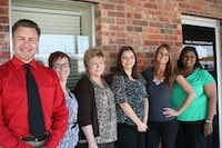 Michael Kovacs' new staff includes Amanda Attaway (from left), Fate's utility billing coordinator; Marty Coursey, finance director; Claudia Lazalde, customer specialist; Ryleigh Valladarez, accountant and budget analyst; and Miranda Duffey, accounting specialist.(Photo by LIZ FARMER/neighborsgo)