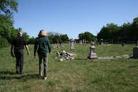 Fountoulakis (right) has been leading cemetery restoration as a volunteer with the Plano Conservancy. All 13 of Plano's historic cemeteries have been worked on to some extent with the help of the group.Staff photo by JULISSA TREVIÑO - neighborsgo
