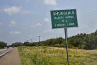 A sign in Brooks County warns of the consequences of smuggling immigrants. The tiny sheriff's department is responsible for close to 1,000 square miles.Ricky Carioti  -  The Washington Post