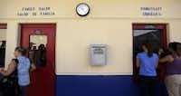 In this July 31, 2014 file photo, a suggestion box hangs on the wall outside of the hair salon and commissary at the Karnes County Residential Center, in Karnes City.(AP Photo/Eric Gay, File)