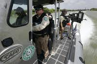 Texas Parks and Wildlife Wardens patrol the Rio Grande on the U.S.-Mexico border last July in Mission.(File 2014 - The Associated Press)