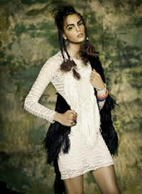 Isabel Marant knit dress, $1,255, V.O.D. Roberto Cavalli Ostrich feather fringe jacket, $3,625, Roberto Cavalli NorthPark. Presmer python bangles, $64 each, Forty Five Ten.THOM JACKSON