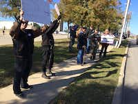 More than a dozen protesters set up near the Islamic Center of Irving.(Avi Selk/Staff)