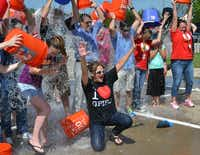 Grand Prairie ISD Superintendent Susan Hull and a few hundred close friends, including Grand Prairie Mayor Ron Jensen, participated in the ALS Ice Bucket Challenge last week at Dubiski Career High School.Photo courtesy of GRAND PRAIRIE ISD