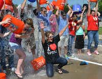 Grand Prairie ISD Superintendent Susan Hull and a few hundred close friends, including Grand Prairie Mayor Ron Jensen, participated in the ALS Ice Bucket Challenge last week at Dubiski Career High School.( Photo courtesy of GRAND PRAIRIE ISD )