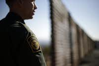 U.S. Border Patrol agent Jerry Conlin looks to the north, near where the border wall ends as it separates Tijuana, Mexico, and San Diego.