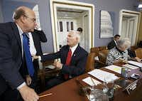 Democratic Rep. James McGovern of Massachusetts (left) speaks with GOP House Rules Committee Chairman Pete Sessions of Dallas on Friday as the panel met to take the procedural steps to bring a new legislative package to the floor.J. Scott Applewhite - The Associated Press