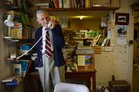 Robert Jones answers a phone call at Imported Books.(ROSE BACA)
