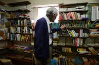 Robert Jones stands among books of various languages in his shop, Imported Books, at 2025 W. Clarendon Drive in Oak Cliff. For more information, call the shop at 214-941-6497.(Photos by ROSE BACA)