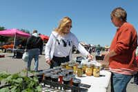 Cheri Bedair purchases scones from Paradise, Texas farmer Jill Holden at the Coppell Farmers Market in Old Town Coppell. Old Town Coppell was ranked No. 3 in the Irving/Coppell area for city dwellers according to a data analysis by The Dallas Morning News.