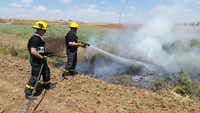 Mesquite firefighter Joe Baker and captain Jeffrey Miller fight a a brush fire in Sderot, Israel. The men joined about 12 firefighters from across the United States to help fight fires in Israel.Photo submitted by JEFFREY MILLER