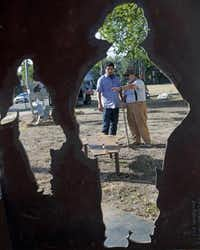 Jose Diaz (left) and sculptor Jim Gallucci figure out where to place the firefighter benches, made from cutouts from the 9/11 Sculpture Project #2 in the foreground.( Ron Baselice  -  Staff Photographer )