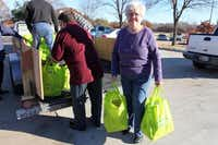 Glenda Stanford helps deliver bags of food at the Goodbar Senior Center at the Portable Pantry distribution day in December. The Portable Pantry Program is a partnership with Mesquite Senior Centers and Mesquite Social Services to help seniors receive food.(Photos submitted by ALYSSA SMITH)