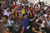 Volunteers chant Shiite slogans at a security forces recruitment drive at a Baghdad stadium. Thousands heeded the call of the nation's top Shiite cleric to take up arms.( Ayman Oghanna  -  The New York Times )