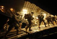 U.S. Army soldiers boarded a C-17 aircraft at Baghdad International Airport for a trip back to the United States in July 2010.