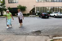 Volunteers Sister Campbell (left) and Sister Shell leave the   Irving Cares food pantry at the end of their shift. Last December, Roy Lee Gooden stabbed and killed his wife Sharon Gooden inside the facility. The event is changing the way the nonprofit serves its clients, and security measures and renovations are being put into place.