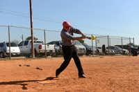 James Hyden, 76, takes a swing during an Irving Eagles softball practice on March 20, 2014 at Fritz Park in Irving. The Irving Eagles is a 65-and-older team that's been active in the Metroplex Senior Softball Association for 30 years.(Rose Baca - neighborsgo staff photographer)