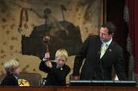 Ten-year-old Aidan Isaac wielded the gavel for his dad, state Rep. Jason Isaac, R-Dripping Springs, as 8-year-old brother Landon watched on Monday.