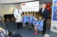 Hyundai recently presented a check for $250,000 to Dr. James Amatruda to fund research for pediatric cancer. Shown from left: Amatruda, Elizabeth Eastham, 6, of Ennis, Avery Anderson, 6, of Lake Dallas, Andrew Pitts, 6, of Richardson, Bennett Williams, 5, of Dallas, Reese Skelte, 5, of McKinney, Rina Cantrell, 5, of Dallas and Kory Rudig of Hyundai Motor America.( Juan Pulido )