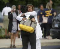 Sharon Cooper (right), the sister of Sandra Bland, embraced a mourner at Bland's funeral in Lisle, Ill., on Saturday.(Joshua Lott - The New York Times)