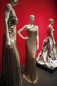 A silk evening gown, courtesy of Anna Wintour and worn by Anne Hathaway at the 83rd Annual Academy Awards, is part of the Oscar de la Renta exhibit.( Ben Torres  -  Special Contributor )