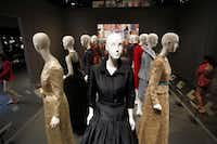 A section dedicated to dresses worn by first ladies features an evening gown worn by Laura Bush in 2007 (center) to greet President Nicolas Sarkozy of France at a social dinner.( Ben Torres  -  Special Contributor )