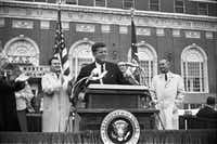 In this Nov. 22, 1963 photo provided by the The Sixth Floor Museum at Dealey Plaza, John F. Kennedy speaks outside the Hotel Texas in Fort Worth, Texas. An exhibit opening next year at the Dallas Museum of Art will feature almost all of the works of art gathered from museums and prominent Fort Worth citizens for the hotel suite Kennedy and first lady Jacqueline Kennedy stayed in the night before he was assassinated.