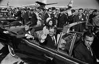HIGH RESOLUTION -- 11/2/1963 -- Pres. John F. Kennedy (back left), Jacqueline Kennedy (back right),  begin the motorcade from Love Field to downtown Dallas on Nov. 22, 1963. Texas Gov. John Connally is waving. (Tom Dillard/The Dallas Morning News) ORG XMIT: DMN3455339Tom Dillard - Staff photographer